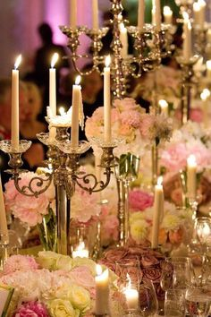 """Romantic candlelight cast a dreamy glow from towering candelabras that ran the length of two banquet tables draped in silky mauve linens. Floral arrangements of varying heights (in tones inspired by the bride's gown) completed the elegant design"", a beautiful wedding with Avalanche and Sweet Avalanche by Meijer Roses! (photo by Inside Weddings -http://goo.gl/aoMhpN)"