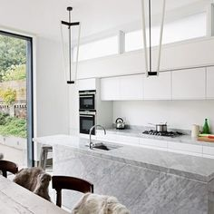See all our kitchen design ideas including this white, modern kitchen. The London home belongs to interior designer Bunny Turner of Turner Pocock.