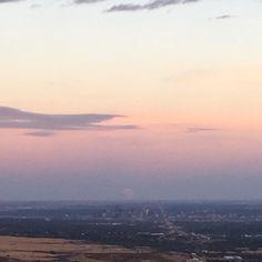 Denver dwarfed by the rising Supermoon  #Supermoon #denver #denversky #denvercolorado #presupermooneclipse #supermoonrise #colorado #milehighcity #milehighsky