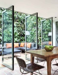 "Glass doors open to outdoor seating area with ""green walls"". Now this is good design. Green Kitchen Decor, Kitchen Ideas, Sliding Patio Doors, Sliding Glass Doors, Pivot Doors, Modern Patio Doors, Panel Doors, Entry Doors, Patio Interior"