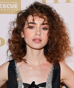Daily Beauty Buzz: Lily Collins Brings Back the '80s Perm from InStyle.com