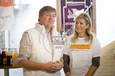 King Willem-Alexander of The Netherlands and Queen Maxima of The Netherlands help painting the gym of community center NL Doet in Tricht. The Netherlands. 21 March 2015.