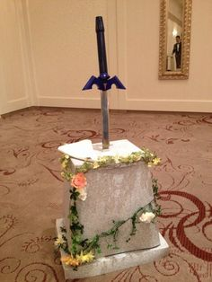 A decorated stand for the Master Sword.  I WILL be cutting my wedding cake with one of these!  *geeking out*