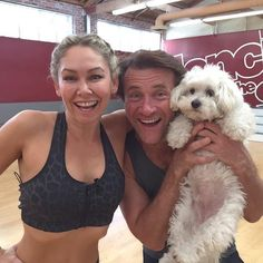 Robert Herjavec holds Lola, girlfriend Kym Johnson's pet dog.