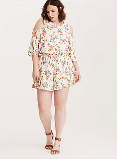 """This romper is a conversation starter. People will obsess over how gorgeous the multi-color floral print is, while you'll be loving how soft the ivory challis is. The crochet trim along the cold shoulder cutout sleeves will get you the adoration of the boho crowd, while the romper shorts (and stretch waistband) are a little bit tomboy-ish with major girly details - is that ruffled trim we see?<div><br></div><div><b>Model is 5'9.5"""", size 1<br></b><div><ul><li style=""""list-sty..."""