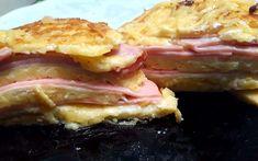 """Η Συνταγή είναι από κ.  Xristina Gewrgiopoulou  – """"Απλές Συνταγές βήμα-βήμα"""".    Υλικά:  1 πακετο ψωμί του τοστ Μεγάλο,μισό κιλό γκουντα τριμμένη,λιγο μαγιονέζα,10 φετες ζαμπόν,10 φέτες μπέικον ρόλο,2κ.σ βουτυρο,5κ.σ γάλα φρέσκο,2αυγα,αλάτι,πιπερι    Εκτέλεση:  Παίρνουμε 8φετες από το ψωμί του Sandwiches, Pork, Meat, Kale Stir Fry, Paninis, Pork Chops"""