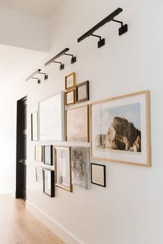 Like the gallery lighting as well (optional) . Our Last Modern Lakehouse Photo Tour — STUDIO MCGEE Hallway Wall Decor, Hallway Walls, Long Hallway, Art Walls, Modern Hallway, Photo Wall Decor, Hall Way Decor, Hallway Wall Lights, Entry Hallway