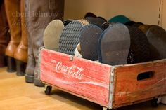 Turn an old soda crate into a wheeled flip-flop holder...  cool idea, but in my house, this would be a flip-flop smorgasbord for my dogs.  oh well.