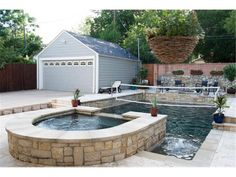 A covered porch, a saltwater pool and spa, and a spacious two-car garage.