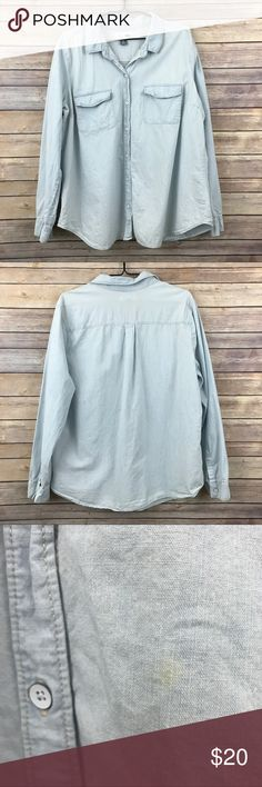 """Old Navy Classic Fit Chambray Buttondown Sz XL 390 This Old Navy Classic Fit button-down collared chambray shirt is a light wash color and is a women's size XL. It measures 23"""" flat across the bust and is 28"""" long. In good preowned condition with one small flaw a light stain near front between second and third buttons from the bottom see all images and light overall wear. Old Navy Tops Button Down Shirts"""