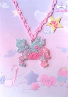 Have you ever dreamed about flying over the rainbow? This fairy enchanted pegasus can take you to a dreamy land! He's translucent and filled with sparkly stars, hearts, marshallows, and has super pop bright colours~ So magical!  It's suspended on a colored fabric chain necklace.  19.80 €♥