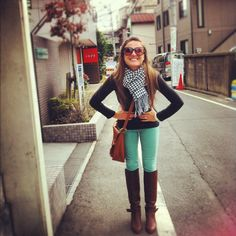 Mint jeans, black shirt, black and white scarf, and boots!