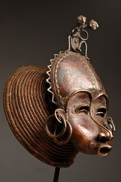 Africa | 'Cimier' Face mask from the Tikar people of Cameroon. | Bronze and Raffia | Early 20th century