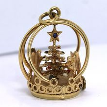 "Vintage 14K Henry Danker and Sons Mechanical Christmas Charm..rare vintage mechanical charm created by Henry Danker and Sons. This magnificent 14k yellow gold piece is powered by a watch movement at the very base. These particular charms were created in limited quantities during the 1960's. The entire charm stands 1.230"" tall and 1.010"" across. Within the charm are two angels on either side of the rotating enameled Christmas tree. A 1.55 mm round blue sapphire rests, bead set, in the top…"