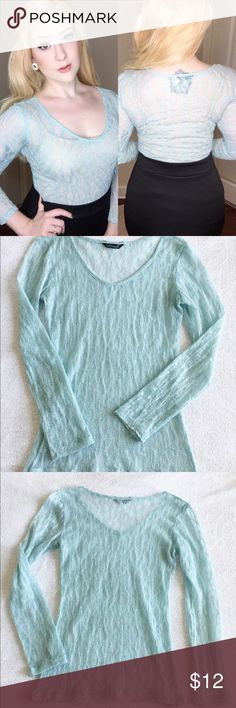 Sheer Silver and Icy Blue Long Sleeve Top ❄️ This sheet ivy blue top with silver tinsle would be so cute for the holidays with snowflake accessories! I wore it with a nude table top but a white or baby blue would also work well! ❄️ Size Small ❄️ no visible signs of wear and tear. ❄️ (measurements are unstretched) Bust: 30 Waist: 24  Hip: 30 ❄️ From a Smoke and Pet free home. Questions? Leave a comment below! Wallflower Tops Tees - Long Sleeve