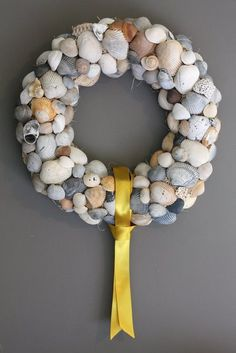 Thinking about doing this (minus the gold ribbon) with all the shells we get over the weekends we go to the beach.