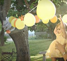 """strings of balloons.  Almost look like lanterns in the photos. """"you are my sunshine"""" 1st birthday party"""