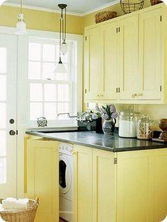 hidden washer and dryer behind lower cabinet doors from Jones Design Company via Atticmag
