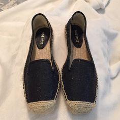 Nine West slips on's Brand new never worn black sparkly Nine West Espadrilles slip on's. Super cute!! Size 6. No trades. Nine West Shoes Espadrilles