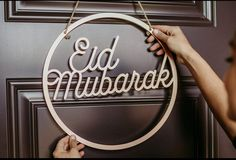Eid Mubarak Door Decor in Rose Gold Welcome your guests this Ramadan and Eid with a decorative door sign made from solid MDF and available in rose gold. .Each door decor piece includes a 1/4 inch adjustable burlap rope that customers can use to hang sign with ease. Our decorative door sign circumference measures 14 inches across and 0.4inch thickness Ramadan, Eid Banner, Eid Mubrak, Eid Holiday, Eid Crafts, Eid Party, Thing 1, Wood Home Decor, Valentine Box