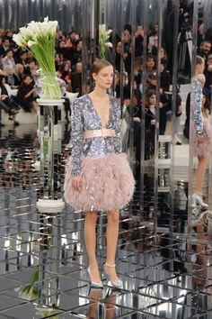 Chanel's runway was completely covered in mirrored glass that complemented all of the sparkling and feather looks, reflecting off all angles as they walked around the runway