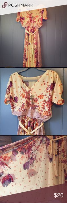 1970's sheer dress This is an absolutely beautiful vintage belted dress.. It's sheer so you would need a slip under.. Floral print is perfect for spring! Tag says 9/10 but I would say it's closer to a small. vintage Dresses Midi