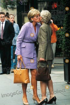 """July 4, 1997: Diana, Princess of Wales leaving """"The Square"""" Restaurant greeting with Diana Donovan in New York City, New York."""