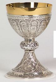 Christ and Apostle symbols on calix, Four Evangelist symbols on base. Gold and antique silver plated brass chalice