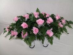 Beautiful Pink Roses Silk Flower Cemetery Tombstone Saddle Arrangement. The graveside saddle adjust to any size tombstone and will last up to 5 months in full sun lite. No shopping, no hassle, no arra