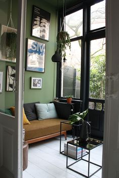 Green wall. Dark colours in a Dutch Home