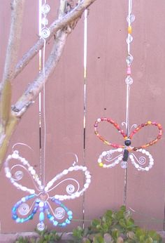 beaded butterfly suncatcher hung on tree