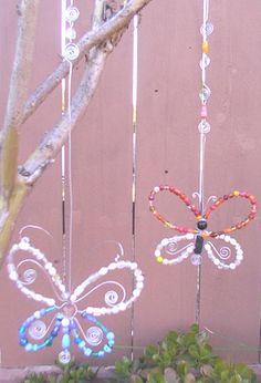 beaded butterfly suncatcher hung on tree