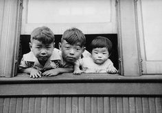 Japanese Canadians - The Canadian Encyclopedia Young Japanese Canadians being relocated in British Columbia, 1942. Library and Archives Canada/C-057251