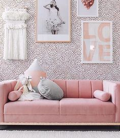 Pretty girls room with spotty wallpaper