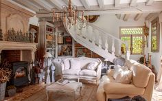 A cozy French home with wood beams and a grand fireplace.