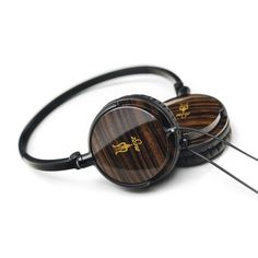 55 Classics by Antonio Meze  Stylish 55mm diameter ear-cup made of ebony wood enclosure reproduces accurate, natural sound and eliminates passive noise. The foldable lightweight headband made of polycarbonate allows for easy carrying.