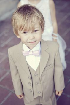 This ring bearer is stinkin' cute: http://www.stylemepretty.com/canada-weddings/ontario/toronto/2013/12/19/casa-loma-wedding/ | Photography: Sarah Kate -  http://sarahkatephoto.com/
