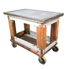 Industrial Cast Iron & Steel Table Cart  USA  1920's  a beautiful and functional antique rolling cart/table with large cast iron wheels, a hefty wood frame, and a steel surface with cast iron frame. perfect for a kitchen island, bar cart, console table, or TV stand.