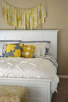 fabric garland. gray and yellow master bedroom