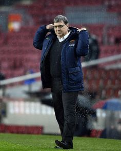 FC Barcelona's coach Gerardo Tata Martino, from Argentina, looks on during a Copa del Rey soccer match against Elche at the Camp Nou sta...