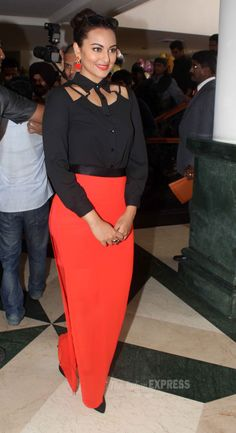 Sonakshi Sinha looking classy in a cutout black top with an orange skirt. #Style…