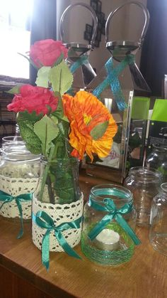 Very simple, just use used jars, lace and ribbons! Very nice for rustic theme