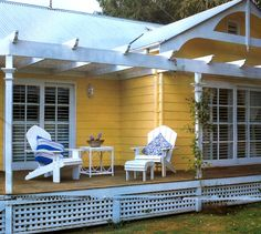deck with arbor and white privacy fence yellow house white deck