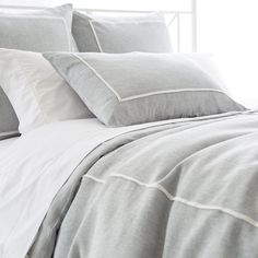 A single ivory pleat stands out against a shadowy sky blue on this tailored linen chambray duvet cover. Pair this duvet with preppy stripes or crisp white sheets and decorative pillows for an easy, coastal look. • 100% linen chambray. • Knife edge. • Hidden button closure.