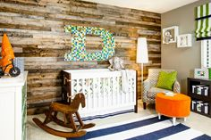 Unfinished wood makes for a cool accent wall in this contemporary nursery where bright colors and bold patterns create a whimsical wonderland. The flexible design scheme will delight its occupant for years to come.