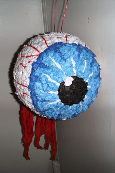 DIY pinata! take a balloon and wrap in paper machete, let dry, and paint!