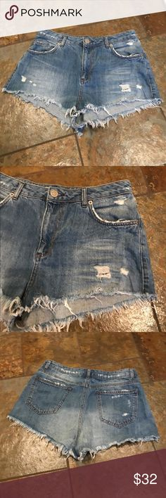 "Top Shop Moto shorts Cute pair of ""TOPSHOP"" moto shorts in gently used excellent condition. Distressed cutoffs with 11"" rise. Waist 30"" . Nonsmoking ****     NO TRADES PLZ😊    Cover photo is just for outfit idea:) Topshop Shorts Jean Shorts"