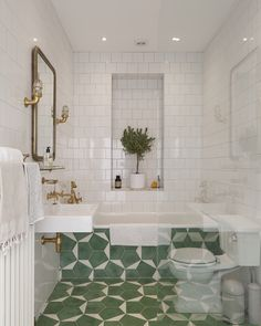 Adore these patterned green tiles in this small bathroom. They are so striking and work so well with the gold taps, mirror and fittings. Laundry In Bathroom, Bathroom Renos, Bathroom Interior, Washroom, White Bathroom, Modern Bathroom, Green Bathroom Tiles, Kmart Bathroom, Disney Bathroom