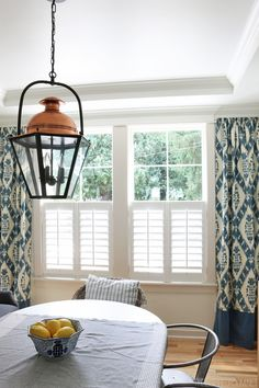 These shutters would be cute in the dining and formal living. The Inspired Room Dining Room - Copper Lantern Plantation Shutters and Ikat Curtains Shutters With Curtains, Cafe Shutters, Ikat Curtains, Interior Shutters, Half Curtains, Drapery, Kitchen Shutters, Long Curtains, Haciendas