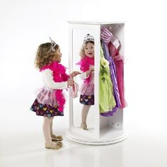 Rotating storage unit creates a smaller footprint suitable for any little princess's playroom or bedroom. Elegant construction holds all dress up needs–dresses, scarves, and boas on one side; purses, shoes, and jewellery in the 5 compartments opposite.